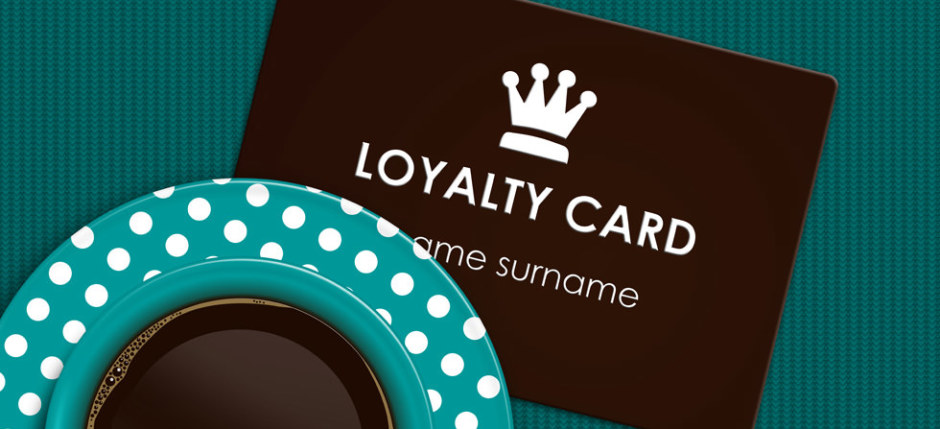 coffee with loyalty card lying on tablecloth